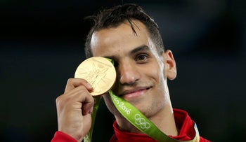 Ahmad Abughaush of Jordan poses with his medal on the podium, Rio de Janeiro, Brazil, August 18, 2016.
