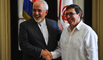 Iranian Foreign Minister Mohammad Javad Zarif shakes hands with his Cuban counterpart Bruno Rodriguez upon his arrival at the Foreign Ministry in Havana, Cuba, August 22, 2016.