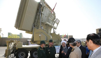 Iran's President Hassan Rohani and Iranian Defense Minister Hossein Dehghan view new air defense missile system, Bavar-373, in Tehran, on August 21, 2016.