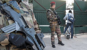"""Armed French soldiers secures the access to the """"La Source"""" Jewish school in Marseille, southern France, January 12, 2016."""