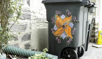Esther Cohen-Eskin's garbage can that was defaced with a large swastika and then she repainted as a flower in Havertown, Pa. Thursday, Aug. 25, 2016.