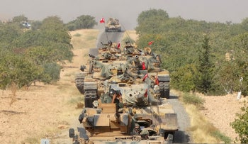 Turkish army tanks make their way toward the Syrian border town of Jarablus, Syria August 24, 2016.