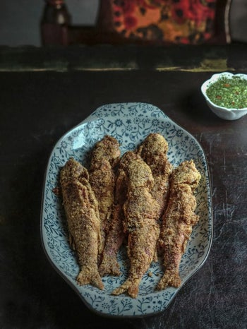 Red mullet coated with cornmeal, fried in deep oil and served with spicy herbs