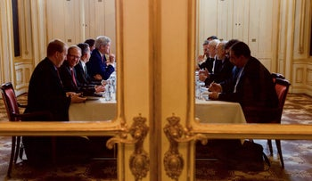 John Kerry, Javad Zarif and their respective advisers discuss the implementation of the Joint Comprehensive Plan of Action outlining Iran's nuclear program, Vienna, January 16, 2015.