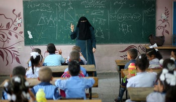 Veiled teacher gives a math lesson in a classroom on the first day of school, at a UN-run school in Khan Yunis in the southern Gaza Strip August 28, 2016.