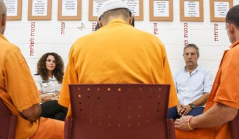 The support group meets at Hasharon Prison, with psychologist Eran Hahn and rehab program director Dorit Cohen, August 2016.
