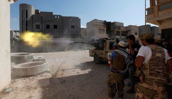 Members of Libyan forces allied with the UN-backed government fire a weapon toward Islamic State militants in Sirte, Libya August 28, 2016.