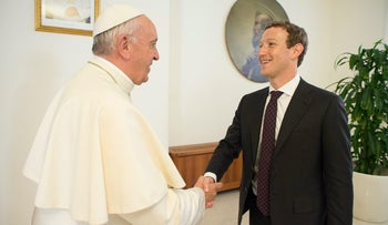 This handout picture released by the Vatican press office shows Pope Francis during a meeting with Facebook founder and CEO Mark Zuckerberg on August 29, 2016, at the Vatican.