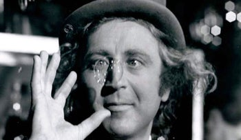 Gene Wilder as the mercurial Willy Wonka amused by one of his creations.