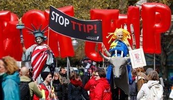 Protesters depicting the Statue of Liberty and Europa take part in a demonstration against Transatlantic Trade and Investment Partnership in Hannover, Germany, April 23, 2016.