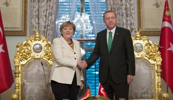 This file photo taken on October 18, 2015 shows German Chancellor Angela Merkel (L) shaking hands with Turkish President Recep Tayyip Erdogan during their meeting in Istanbul.