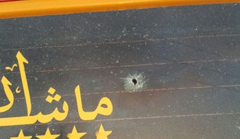 The BB gun allegedly fired by a settler of 18 damages a Palestinian taxi's windshield, on August 24, 2016.