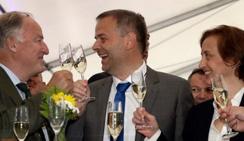 From left, AfD member Alexander Gauland, Leif-Erik Holm, top candidate of the AfD , and AfD member Beatrix von Storch,  toast at the gathering of the AfD (Alternative for Germany) party in Schwerin, Germany, Sunday, Sept. 4,  2016.