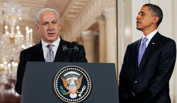 Prime Minister Benjamin Netanyahu makes a statement on Middle East Peace talks as U.S. President Barack Obama looks on in the East Room of the White House in Washington September 1, 2010.