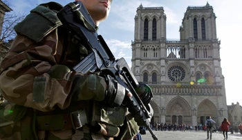 A file photo showing an armed French soldier patrolling in front of Notre Dame cathedral in Paris, France, on December 24, 2015.