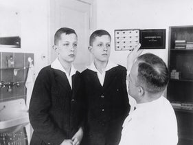 Twins being examined by a Nazi doctor.