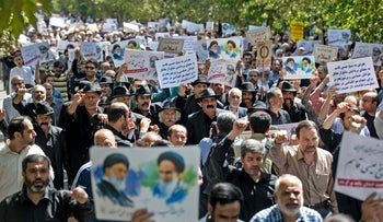 Iranian protesters chant slogans against the ruling Al Saud family of Saudi Arabia, America and Israel after weekly Friday prayers in Tehran, September 9, 2016.