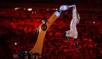 Amputee Amy Purdy dances with a robot during the opening ceremony of the Rio 2016 Paralympic Games at Maracana Stadium in Rio de Janeiro, Brazil, Wednesday, Sept. 7, 2016.