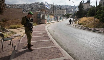 An IDF soldier guarding the Jewish settlement in Hebron.