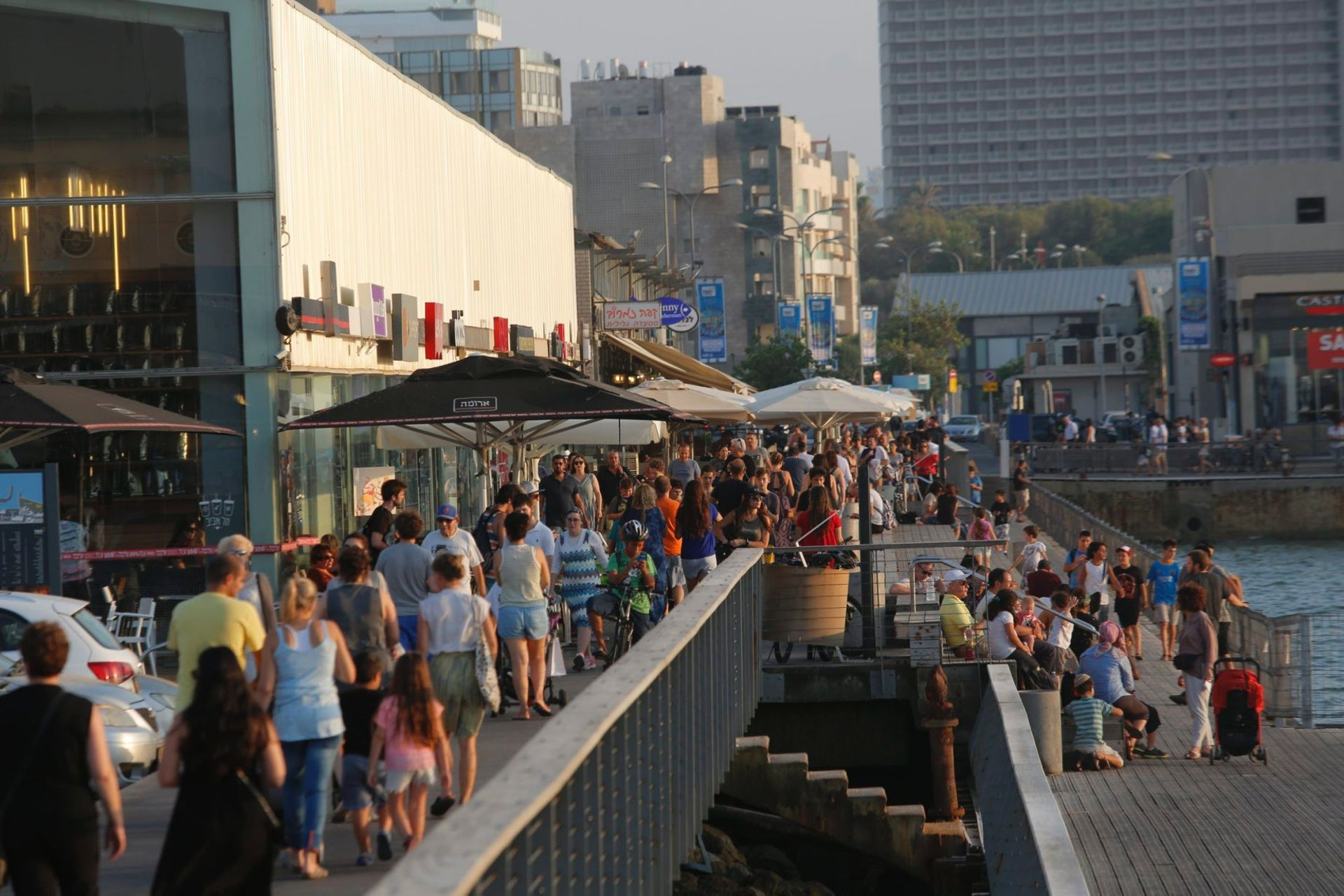 The bustling Tel Aviv Port: One of only three places allowed to open in the city on Shabbat.