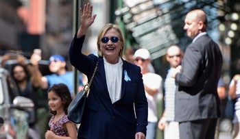 U.S. Democratic presidential nominee Hillary Clinton waves to the press as she leaves her daughter's apartment building after resting on September 11, 2016, in New York.