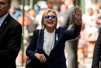 Democratic presidential candidate Hillary Clinton waves after leaving an apartment building Sunday, Sept. 11, 2016, in New York.