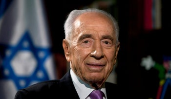 Then-President Shimon Peres gives an interview to the Associated Press at the President's residence in Jerusalem June 16, 2013.