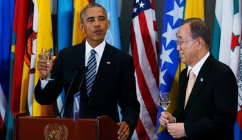 U.S. President Barack Obama toasts as UN Secretary General Ban Ki-moon listens at the UN General Assembly on September 20, 2016.