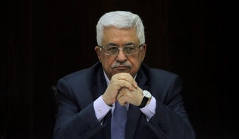 Palestinian President Mahmoud Abbas heads a Palestinian cabinet meeting in the West Bank city of Ramallah, July 28, 2013.