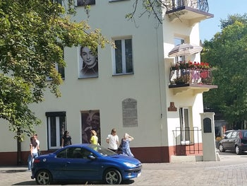7 Planty St., Kielce, where the July 4, 1946 pogrom took place. The building is now a museum commemorating the pogrom. Some of the windows have been replaced with images of victims of the pogrom.