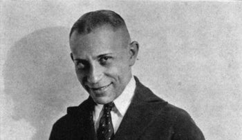 Erich von Stroheim: actor, director, screenwriter, producer. Image of actor in black and white smiling at camera.