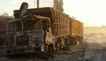 Damaged aid trucks are pictured after an airstrike on the rebel held Urm al-Kubra town, Aleppo, Syria, September 20, 2016.