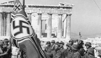 German soldiers raising the Nazi flag over the Acropolis in Athens, Greece.