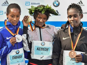 Women's Berlin marathon winner Aberu Kebede, center, flanked by Birhane Dibaba, left, and  Ruti Aga, all from Ethiopia, on Sunday.