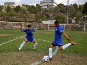 Players from Ariel Municipal Soccer Club, who are affiliated with Israel Football Association, train ahead of their match with Maccabi HaSharon Netanya at Ariel Municipal Soccer Club's training grounds in the West Bank Jewish settlement of Ariel September 23, 2016.