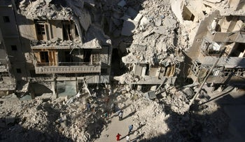 People search for survivors at a site hit previously by an airstrike in the rebel-held Tariq al-Bab neighborhood of Aleppo, Syria, September 26, 2016.