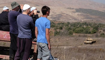 Druze observing the fighting in Syria, from the Golan, September 2016.