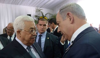Image released by Israeli Prime Minister's spokesman shows Palestinian president Mahmoud Abbas shaking hands with Benjamin Netanyahu during funeral of Shimon Peres in Jerusalem on September 30, 2016.