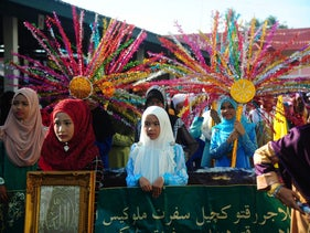 Women take part in a parade to celebrate Muharram, the first month of the Islamic calender, in the Tak Bai district of Thailand's southern province of Narathiwat on October 2, 2016.