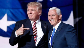 A file photo from July 20, 2016, shows Republican presidential candidate Donald Trump with his vice presidential candidate Indiana Gov. Mike Pence in Cleveland.