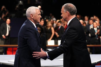 Mike Pence and Tim Kaine shake hands on stage following the Vice Presidential Debate at Longwood University on October 4, 2016 in Farmville, Virginia.