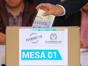 A voter casts his ballot in a referendum to decide whether or not to support a peace deal signed between the Colombian government and FARC in Bogota, Colombia, Sunday, Oct. 2, 2016.