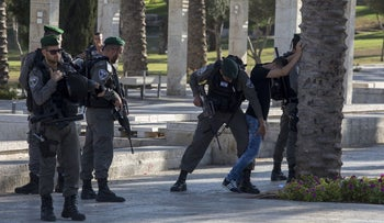 Border Police officers perform a search near the Damascus Gate in Jerusalem, September 2016.