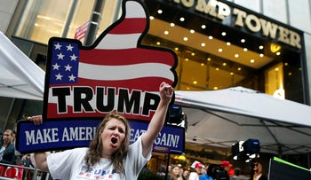Supporters of Republican presidential nominee Donald Trump stand outside Trump Tower where Trump lives, in the Manhattan borough of New York, U.S., October 8, 2016.
