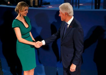 Former U.S. President Bill Clinton greets Ivanka Trump, daughter of Donald Trump, before the start of the second U.S. presidential in St. Louis, Missouri on October 9, 2016.