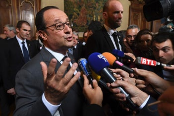 French President Francois Hollande talks to the press on October 8, 2016 in Tulle as part of his visit in Correze.