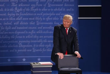 Donald Trump, 2016 Republican presidential nominee, reacts during the second U.S. presidential debate at Washington University in St. Louis, Missouri, U.S., on Sunday, Oct. 9, 2016.