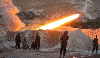 FILE PHOTO: Free Syrian Army fighters launch a Grad rocket from Halfaya town in Hama province, September 2016