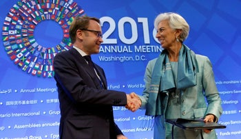 Christine Lagarde, right, and  Bundesbank President Jens Weidmann at the IMF/World Bank annual meetings, Washington, October 8, 2016.