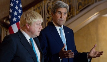 British Foreign Secretary Boris Johnson and U.S. Secretary of State John Kerry give a joint press conference on the situation in Syria in London on October 16, 2016.